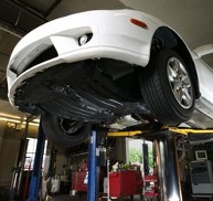 White Car on a Lift, MOTs in Salford, Lancashire